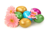 Easter eggs and flowers on white background