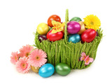 Basket with easter eggs on white background