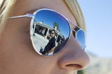Police Officer Reflected in Sunglasses