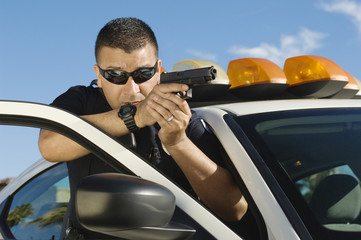 Police Officer Aiming Handgun