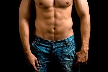 Torso of muscular man with nice abdomen