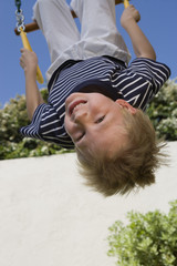 Little Boy Upside Down on a Swing