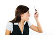 Angry businesswoman shouting to mobile