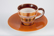 Orange Coffee Cup on White background
