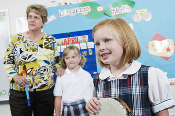 Elementary Student with Tambourine in Music Class