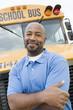 Teacher in Front of School Bus