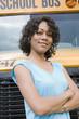 School Teacher in Front of School Bus