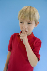 Boy with Finger on Lips