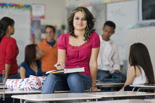 High School Student Sitting on a Desk