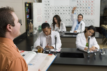 Student Raising Hand in Science Class