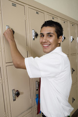 High School Boy Opening Locker
