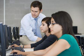 Teacher Helping Computer Students