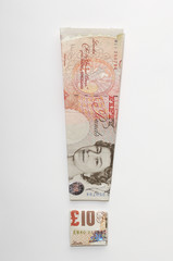 Exclamation mark symbol made of folded banknotes