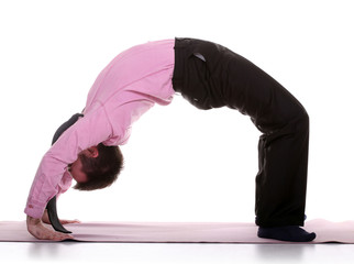 Businessman in yoga bridge position