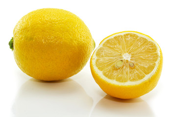 Fresh yellow lemon and slice isolated