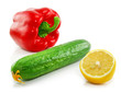 Green cucumber, red paprika and yellow lemon isolated
