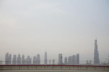 dubai, uae, dubai's skyline from nad al sheba camel racetrack