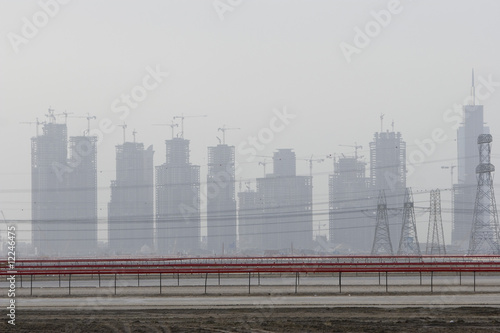 dubai, uae, partial view of dubai?s skyline from nad al sheba camel racetrack