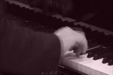 Pianist playing piano,with pretty haul of the hands
