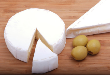 cheese camembert on grocery board