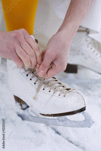 Putting on ice skates