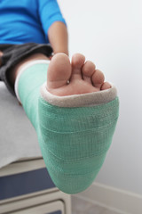 Detail of boy's leg in plaster cast