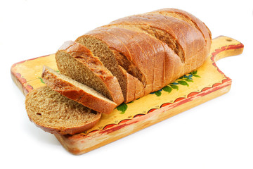 Whole wheat bread on the table wooden board isolated