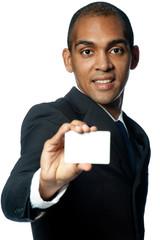 Businessman holding a blank card