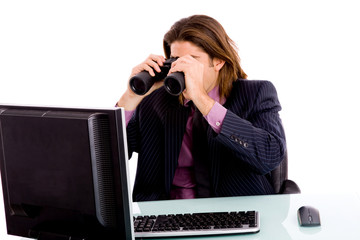 portrait of businessman looking monitor through binocular