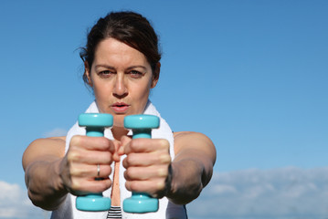 fit healthy woman exercising with weights