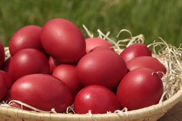 Basket with red Easter eggs
