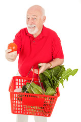 Senior Man Shops for Produce