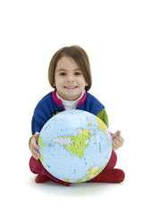 Little girl embracing the world globe isolated on white