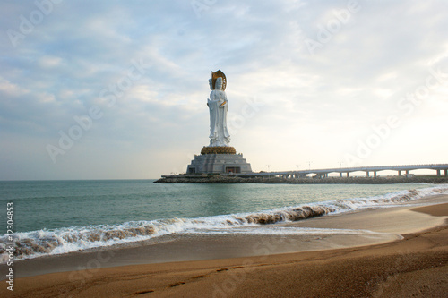 Statue of Guanyin, Chinese goddess, far view from seashore