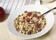 fruity muesli in white bowl