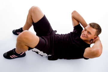 high angle view of muscular man doing crunches