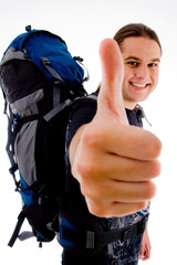 side pose of happy traveler with thumbs up