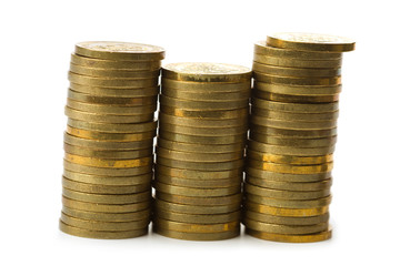 three stacks of golden coins isolated