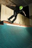 Skateboarder doing a grind on ramp poster