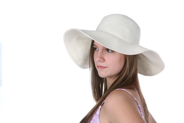pretty teenage girl with floppy white straw hat