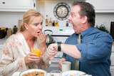 Couple in Kitchen Stressed & Late for Work poster