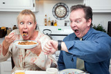 Stressed Couple in Kitchen Late for Work poster
