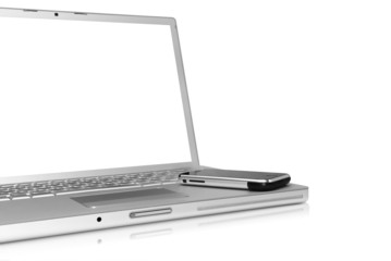 Glossy silver laptop with cellphone