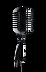 Retro microphone on stand isolated on black