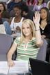 Female University student raising hand in class