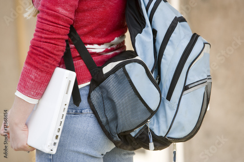 Mid section of a female student wearing backpack