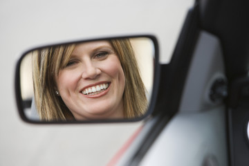 Woman in Side-View Mirror of Car