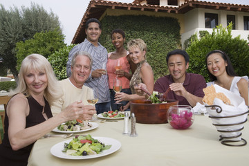 group of friends dining outdoors, portrait
