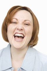 Mature woman laughing, portrait