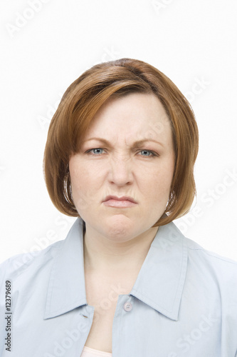 Portrait of mature woman, grimacing